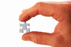 Puzzle in hand Stock Photos