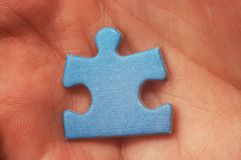 Puzzle in hand royalty free stock photo