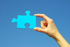 Puzzle in hand Royalty Free Stock Image
