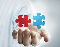 Puzzle in the hand of businessman Royalty Free Stock Image