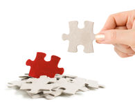 Puzzle in hand and heap puzzles Royalty Free Stock Photography