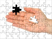 Puzzle hand without one piece stock images