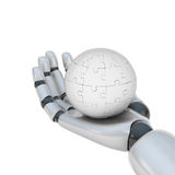 Puzzle in hand of robot Stock Photography