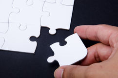 Puzzle and hand Royalty Free Stock Images