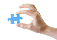 Puzzle in hand on white background Stock Image