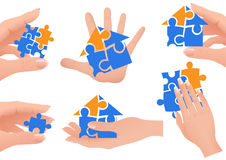 Puzzle in hands Stock Photo