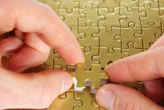 Puzzle in hands Stock Image