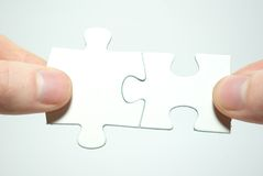 Puzzle in hands Stock Photography