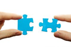 Puzzle in hands stock images