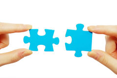 Puzzle in hands Royalty Free Stock Photo
