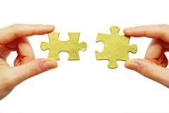 Puzzle in hands Royalty Free Stock Images