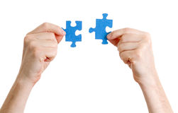 Puzzle in hands on white background Royalty Free Stock Image