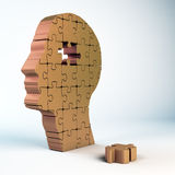 Puzzle head. A male head build out of puzzle pieces stock images