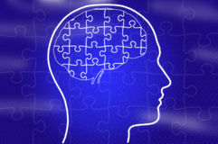 Puzzle in head on blue background Royalty Free Stock Photos