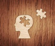Human head profile made from brown paper with puzzle. royalty free stock image