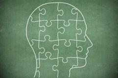 Puzzle in head on chalkboard Royalty Free Stock Image