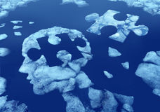 Puzzle Head Idea. And concept as a human face profile made from floating ice floating away in water with a jigsaw piece cut out on a cold blue arctic background Stock Photography