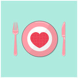 Puzzle heart on disk with fork and spoon. valentine 's day symbo Stock Images