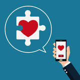 Puzzle Heart. Smart phone in hand with find love. Valentine's Day. Royalty Free Stock Photo