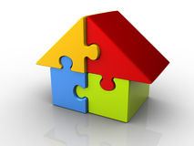 Puzzle house. Puzzle pieces arranged in a house shape - 3d render Royalty Free Stock Photo