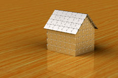 Puzzle house. House made out of puzzle pieces on wooden surface Royalty Free Stock Photography