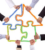 Puzzle house. Hands holding puzzle, house concept Royalty Free Stock Photo