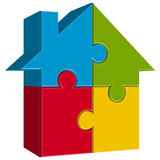 Puzzle house with four parts Royalty Free Stock Images