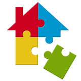 Puzzle house with loose part Stock Photos