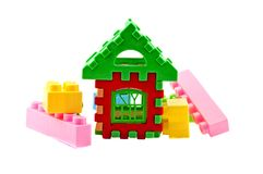 Puzzle house. Toys like a house on a green background Royalty Free Stock Photo