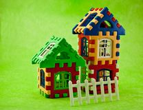 Puzzle house. Toys like a house on a green background Royalty Free Stock Photography