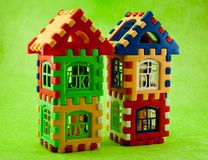 Puzzle house. Toys like a house on a green background Royalty Free Stock Images