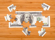 Puzzle of a hundred dollar bill Stock Photo