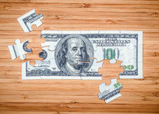 Puzzle from hundred dollar bills Stock Photo