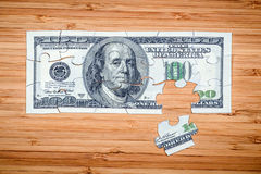 Puzzle from hundred dollar bills Stock Image