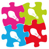 Puzzle of ideas. A green purple blue red puzzle with bulbs within them Royalty Free Stock Photos
