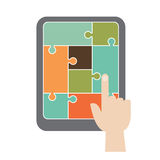 Puzzle. Infographic concept, a finger is touching a tablet Stock Photos