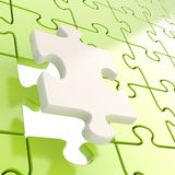 Puzzle jigsaw background with one piece stand out Royalty Free Stock Image