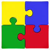 Puzzle jigsaw pieces. 4 connected puzzle pieces isolated on white background. jigsaw piece are colored in yellow, blue, green and red Stock Photos