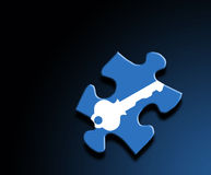 Puzzle Key Theme. A photo of a puzzle piece with a key overlay Stock Images