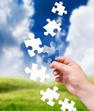 Puzzle and landscape Stock Photography