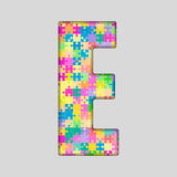 Puzzle Letter Alphabet - E. Colored Puzzle Piece. Stock Photo