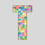 Puzzle Letter Alphabet - T. Colored Puzzle Piece. Stock Image
