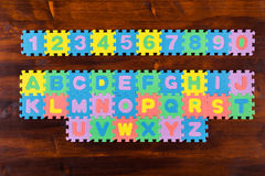 Puzzle letters on wooden background Stock Photo