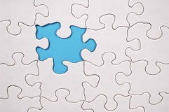 Puzzle With Light Blue Background. PPhoto of Puzzle With Light Blue Background. Part of Series Royalty Free Stock Photo