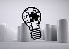Puzzle light bulb Stock Image