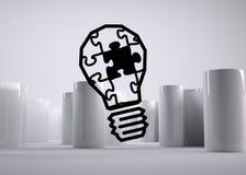 Puzzle light bulb Stock Image