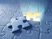 Puzzle. Light shining through a puzzle Royalty Free Stock Images
