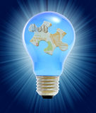 Puzzle in lightbulb as a concept Stock Images
