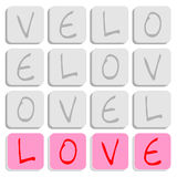 Puzzle of love. Puzzle of square letter blocks spelling love Stock Photos