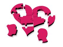 Puzzle Love. Broken puzzle of heart with mand and woman heads Stock Photography